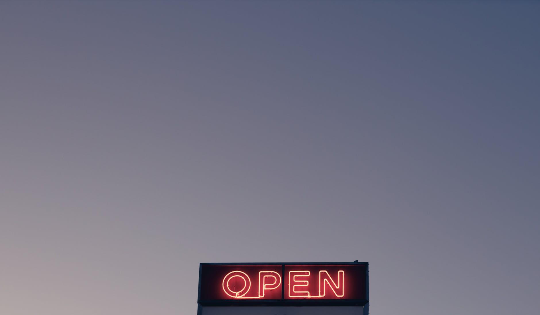 open sign under cloudless evening sky